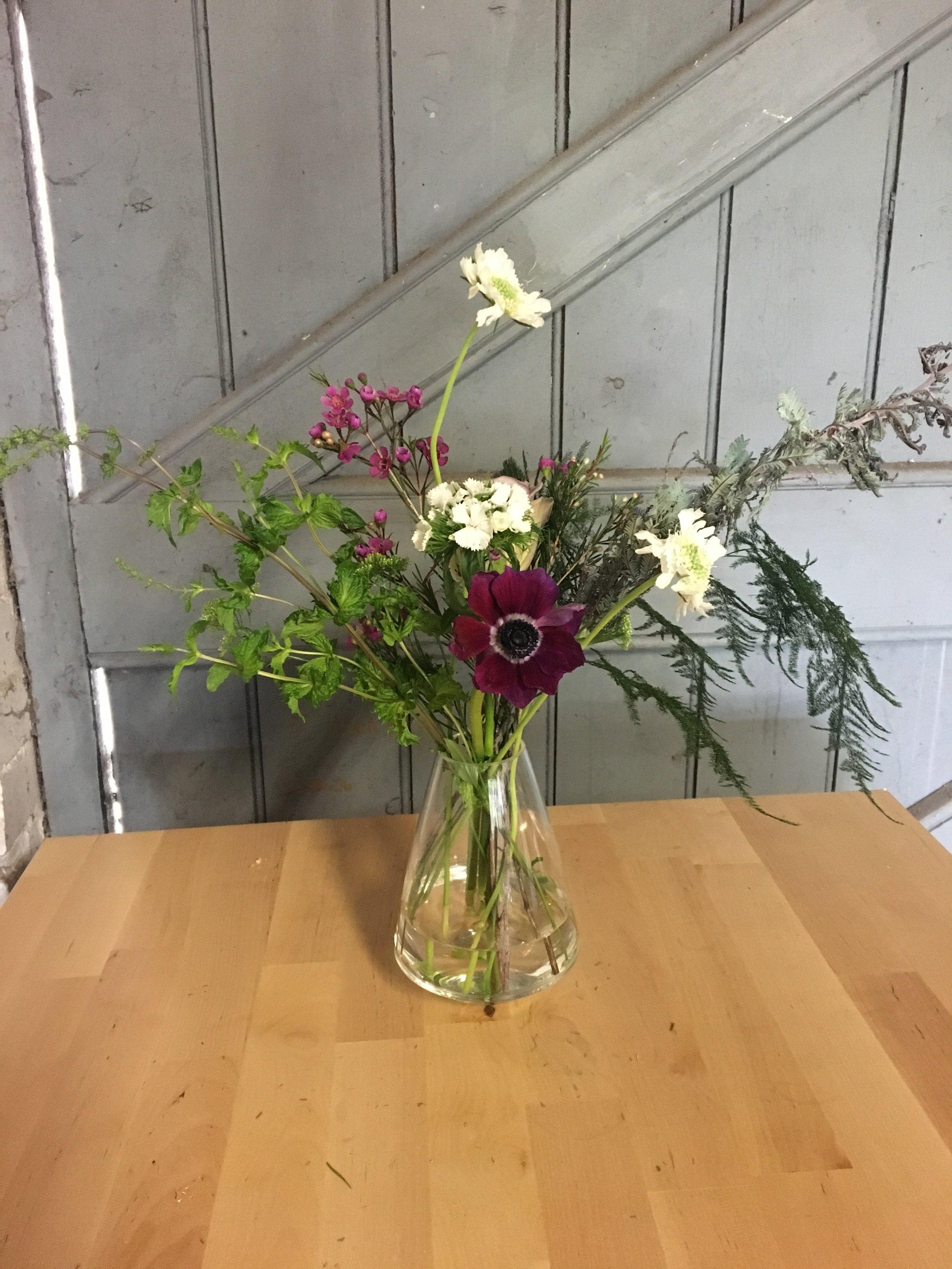 Anemone and wax flower arrangement