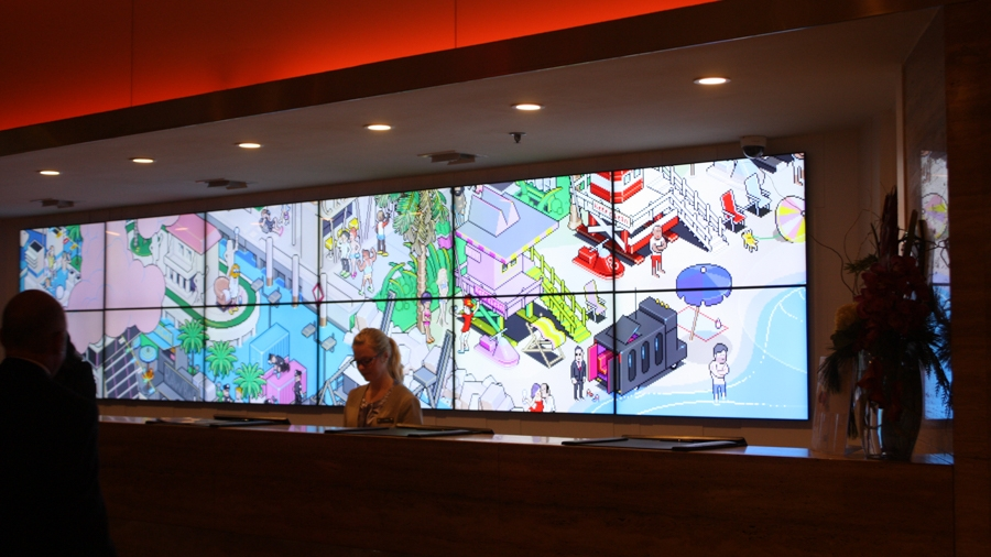 Use of the lobby's screens to display the artwork