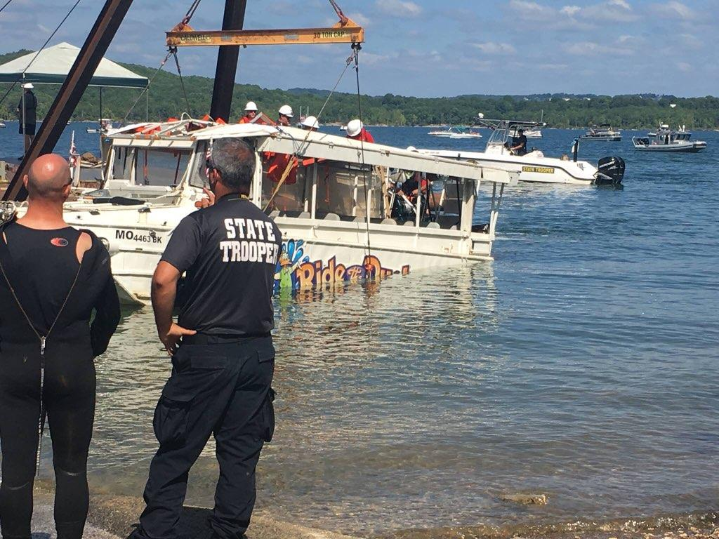 Billy Cole (left) watches as wreckage from the Branson, MO duck boat tragedy is lifted from the waters. Part of the Missouri Underwater Search and Recovery Team, Billy was one of the First Responders working to recover victims.