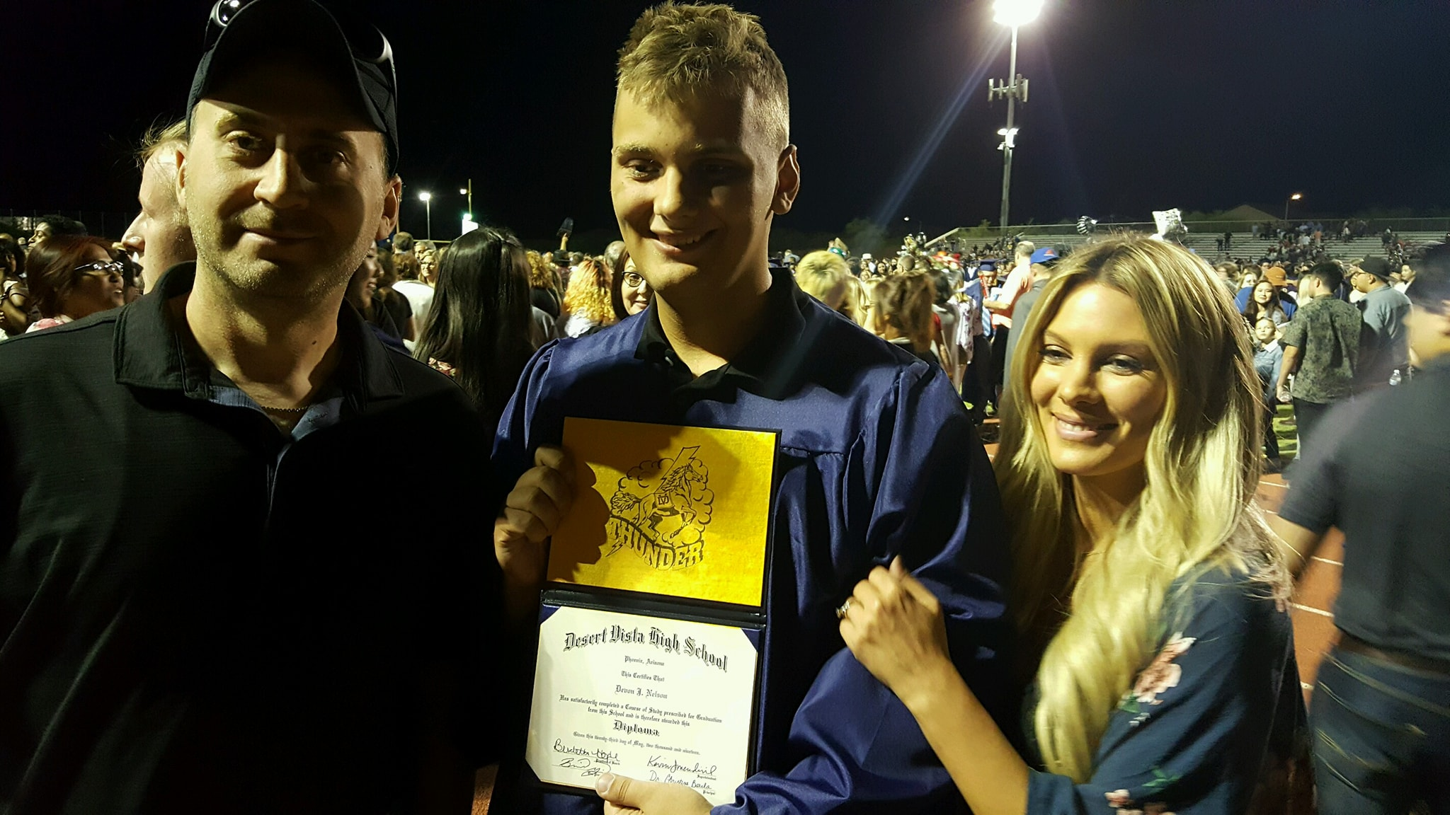 Devon, with his parents, Chad and Becky Nelson