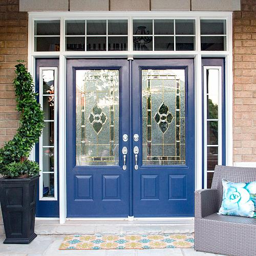 Well thought-out use of color on your front door with seating can create an inviting entryway and increase your curb appeal.