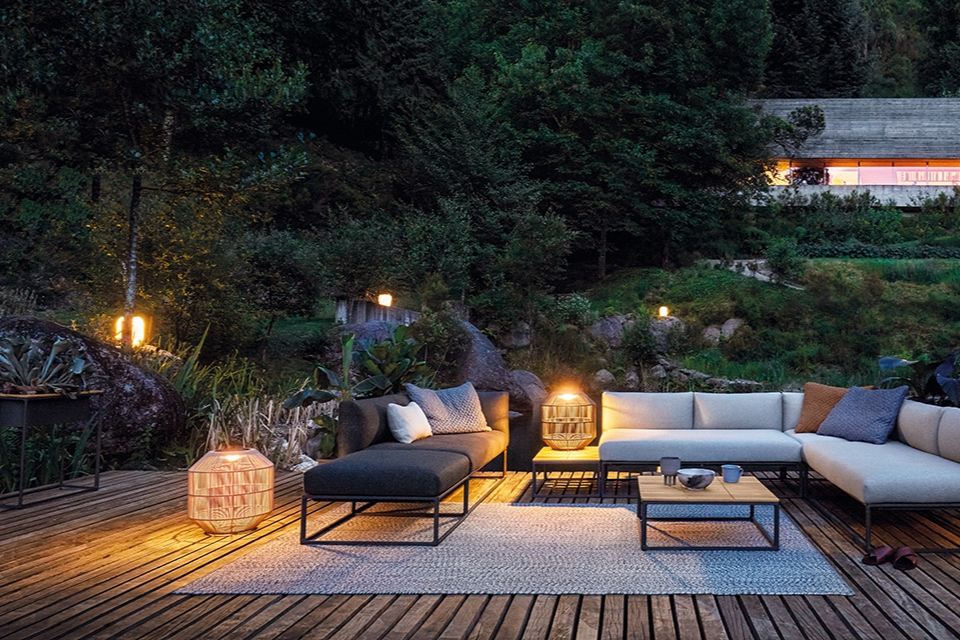 Outdoor rugs are easy to clean and help to ground your design concept.