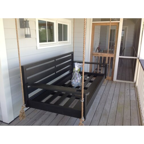 - The John's Islander Porch Swing, sold by Wayfair, is a fun addition to any outdoor space.
