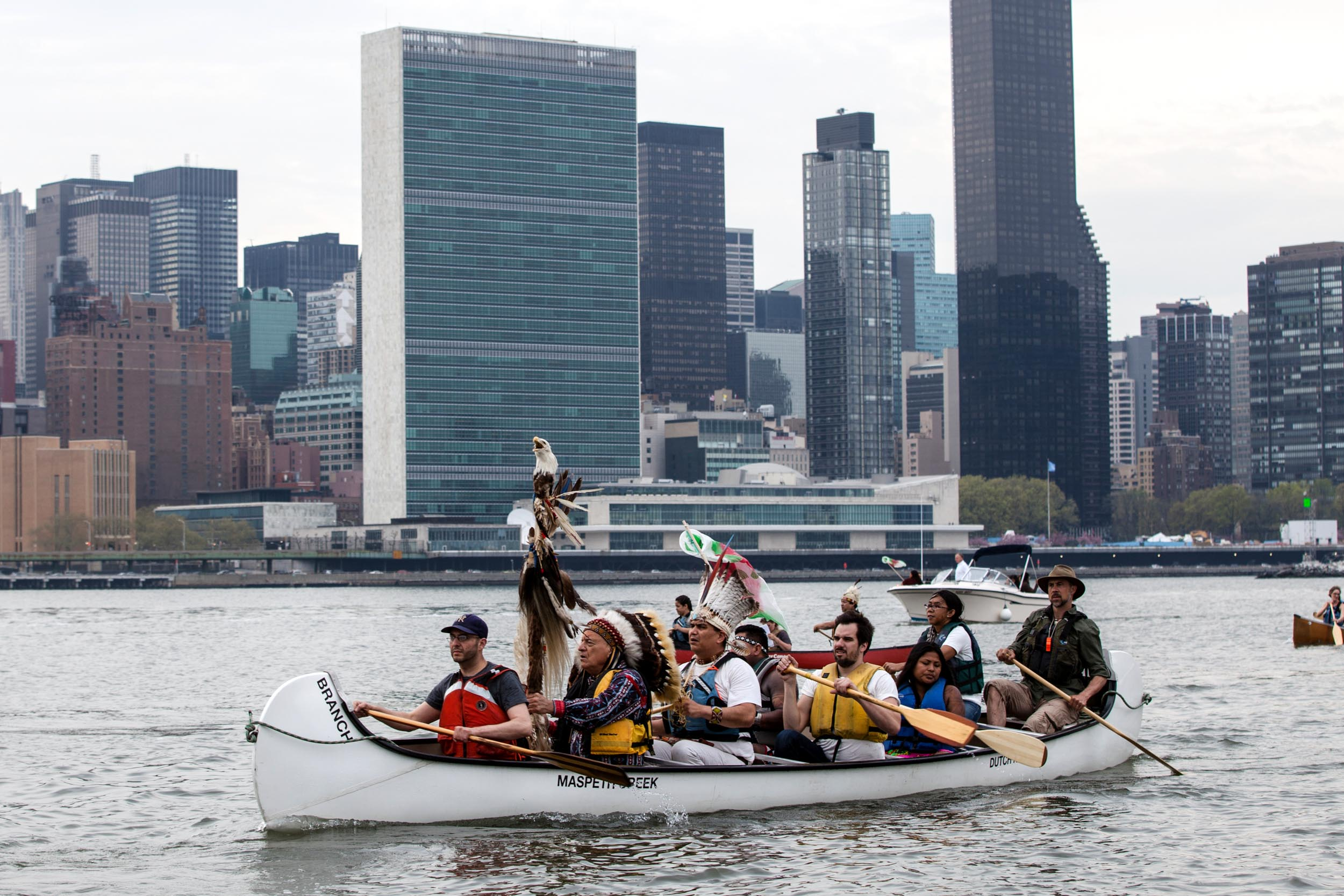 International indigenous leaders stage an action paddling canoes to NYC's UN building, where 2016 climate talks were taking place without their inclusion.