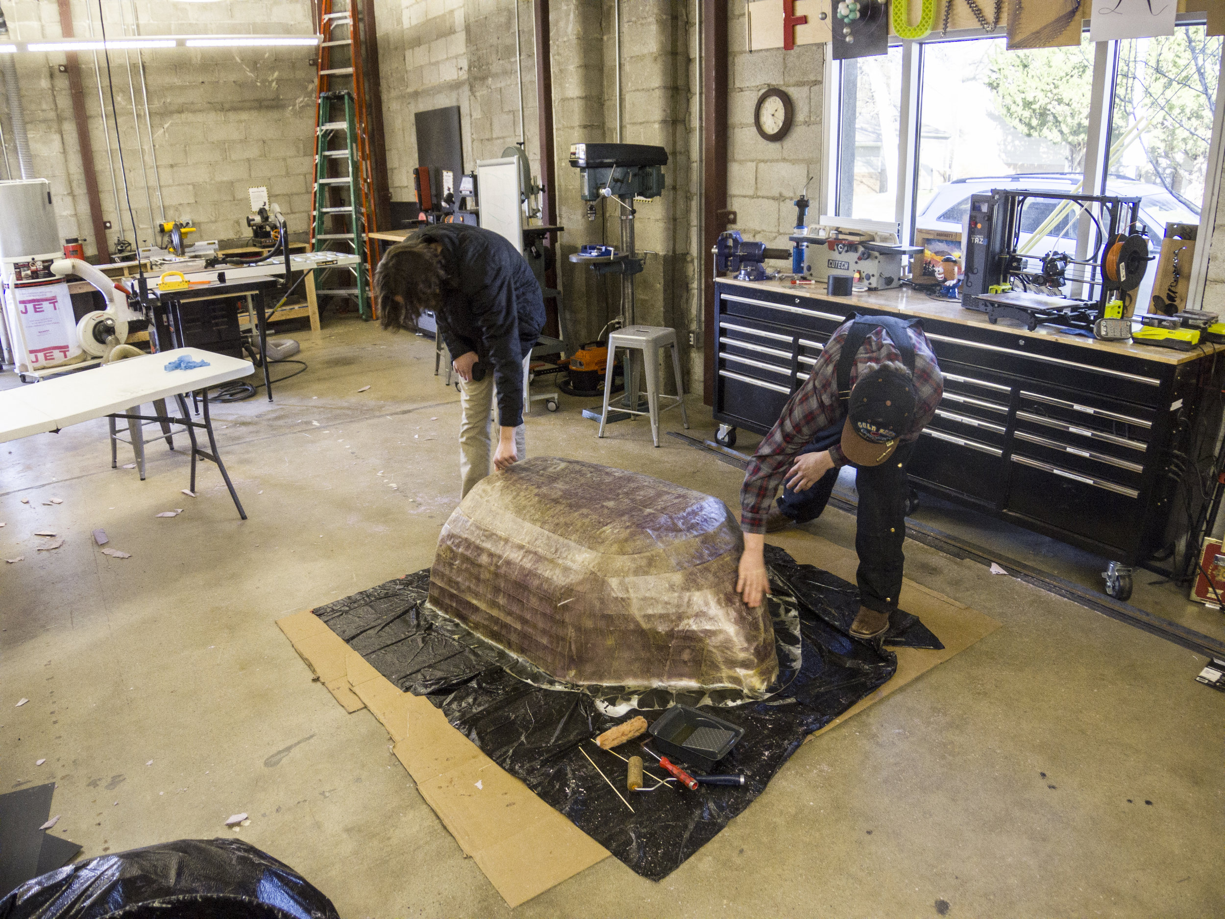 Students build a human-powered submarine in One Stone's foundry.