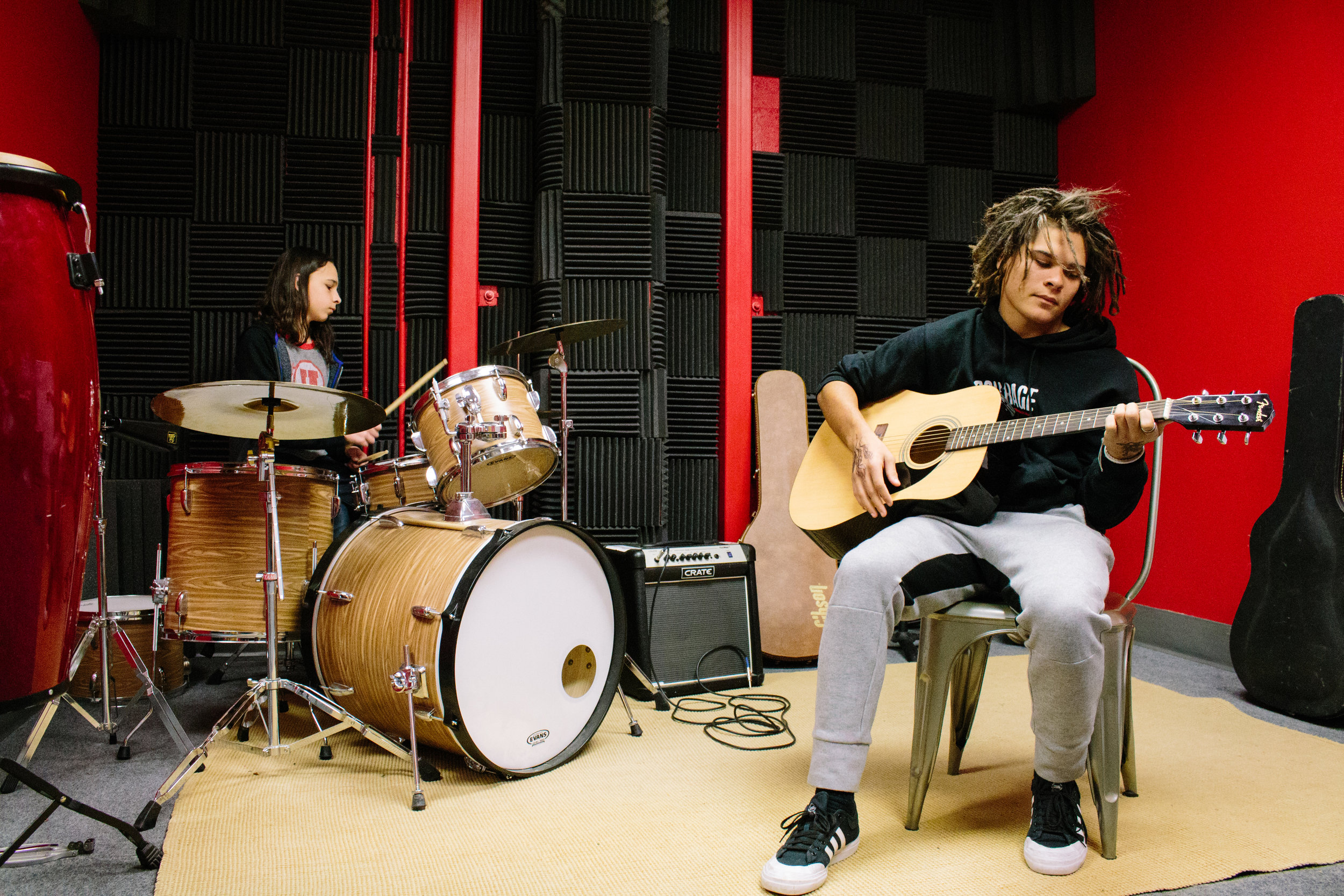 Students create and record music in One Stone's Ripple Studio.