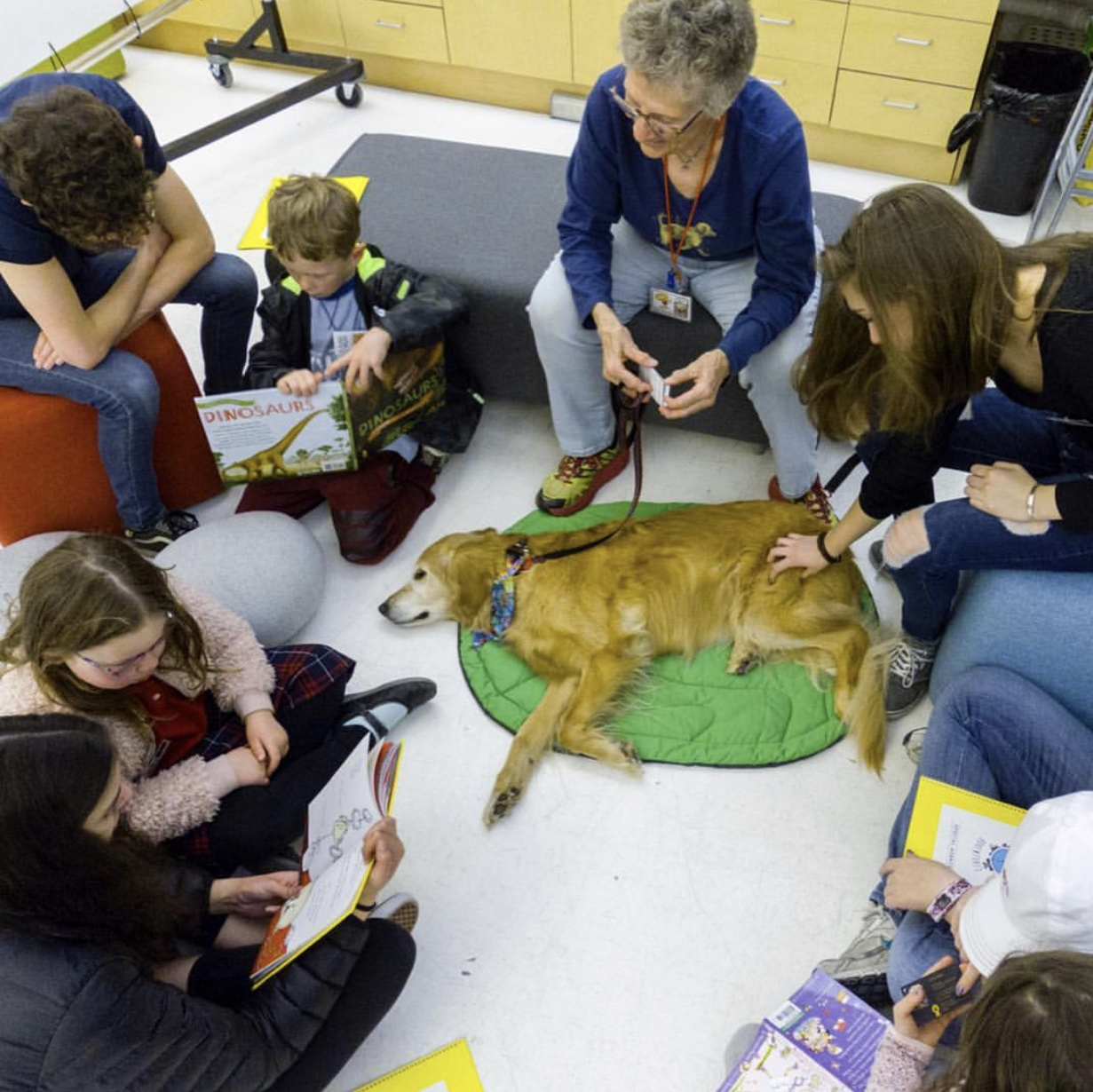 Open Book Adventure participants reading to a patient listener…and a doggie partner!
