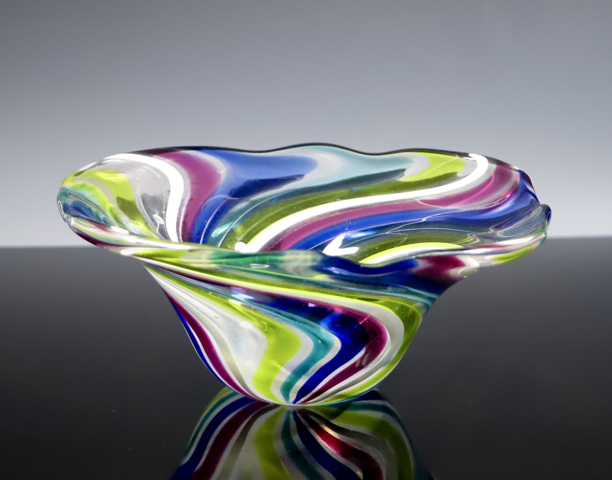 Designer Cane Bowl - This intricate design was carefully calculated by Tekla and her team, because this was no ordinary bowl. What you see are two different major processes brought together into one piece.One process being to make the choice design of cane and the next process to incorporate the cane into the glass blown bowl.