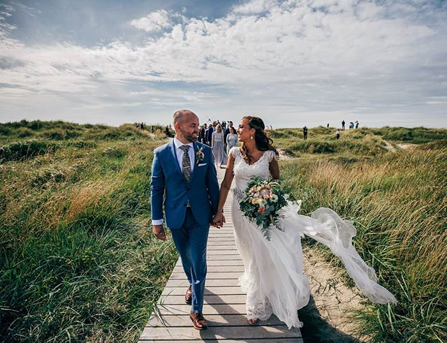 "Now THIS is how you exit a ceremony... ☀ Love the ""aisle"" for Stefan and Helene's Norwegian beach wedding. And we had perfect sunshine and just enough wind to keep us cool as we headed out to do portraits! 😎 . . . #stavangerfotograf #stavangerbryllup #solastrandhotell #solastrand #strandbryllup #rogalandfotograf #bryllup2020 #bryllupsfoto #brudepar #bryllupsplanlegging #arnesonfoto #dittbryllup #norwegianwedding #norwaywedding"