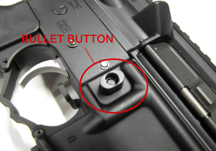 """(A bullet button is a device used to remove a magazine in a semiautomatic rifle, replacing the magazine release button with a block which forces the user to remove the magazine by using a tool (often the tip of a bullet)as opposed to his or her finger, which then de-classifies the rifle as an """"assault rifle"""" and complies with CA's laws.)"""
