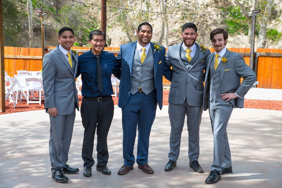 groom and groomsmen yellow boutonnières