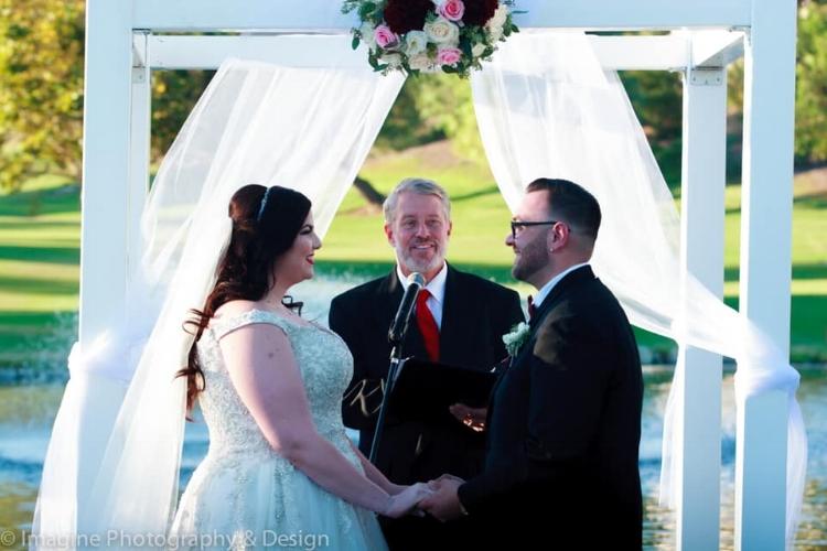 burgundy and blush arch wedding arrangement
