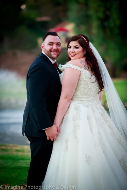 bride and groom red wedding flowers