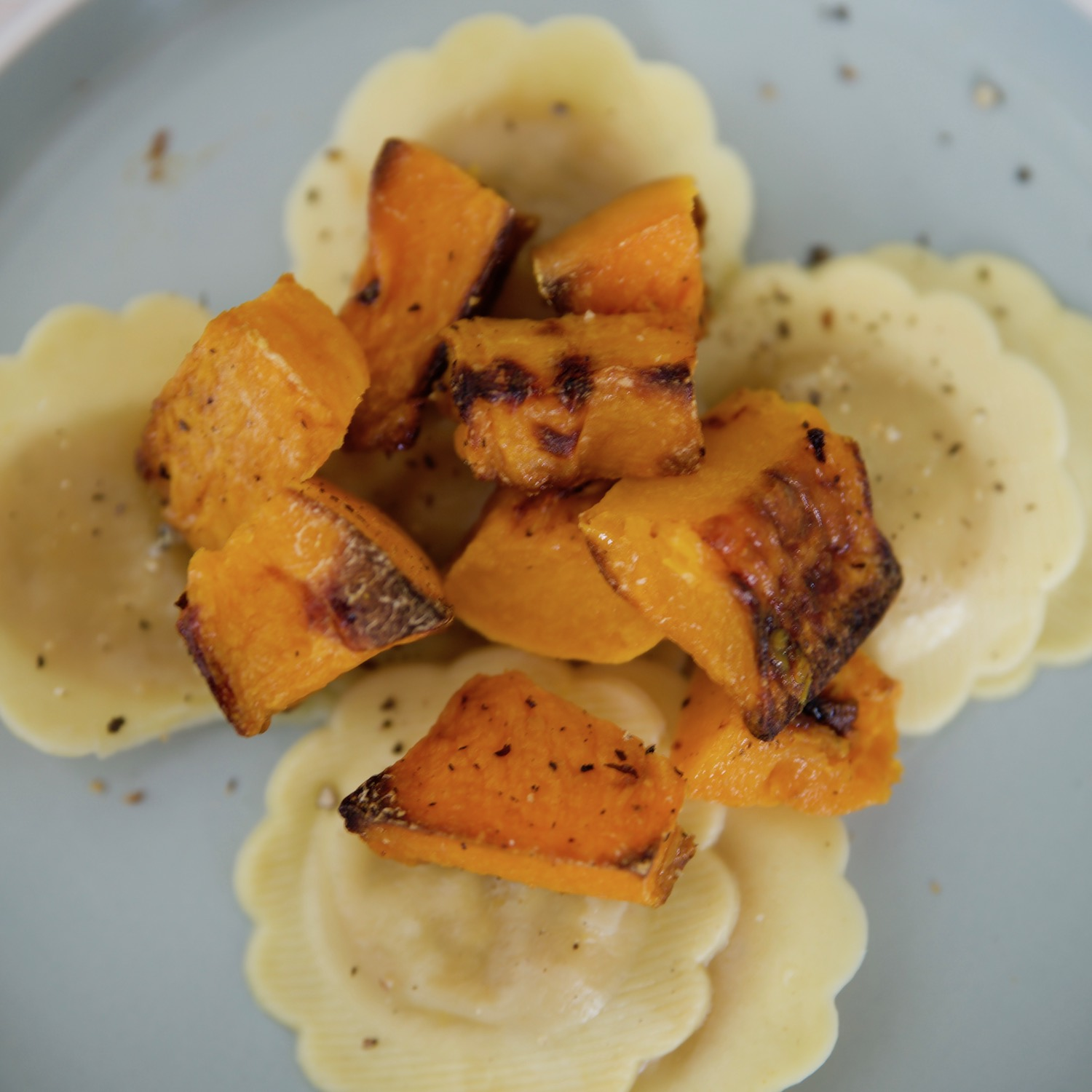 Butternut ravioli topped with roast butternut.jpg