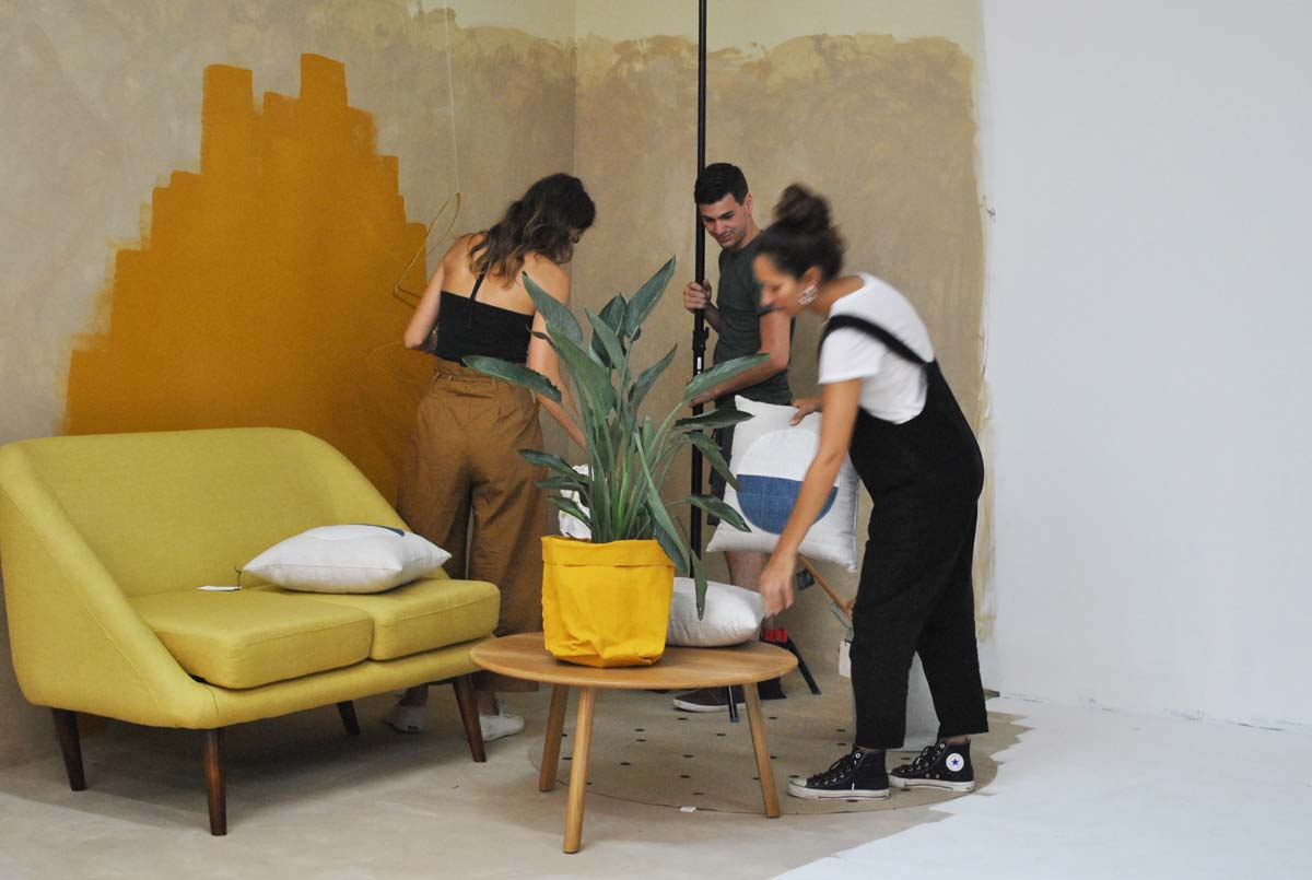 Photo Stylist  Jessie Cundiff  directs her team on set at an interiors shoot at  Brooke Shanesy 's studio—check the freshly painted walls and fly color palette.