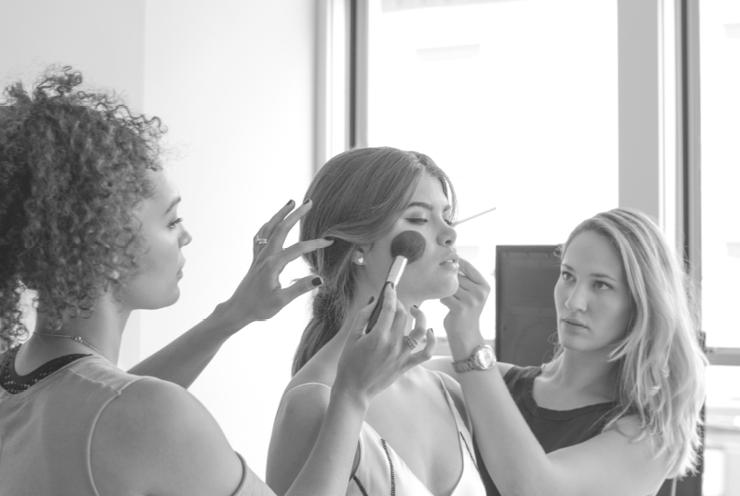 Makeup artist Laura Vega, model Emma Karle, and hair stylist Tara Tussing Wood