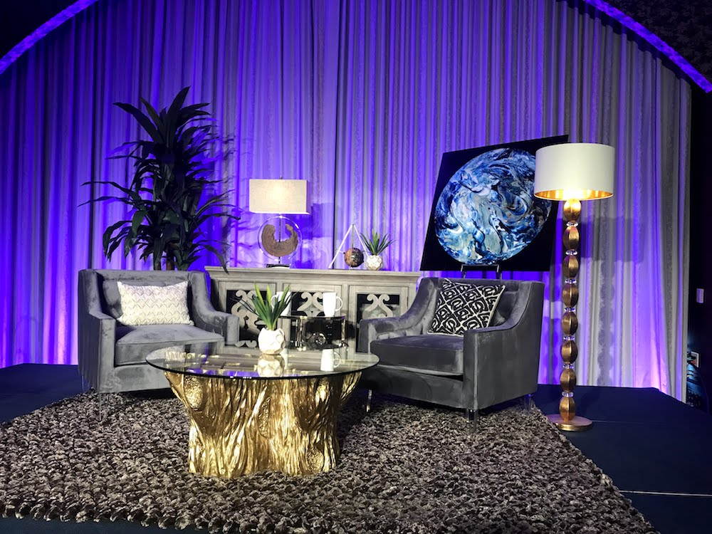 "The final set design for the event. Note the ""space nuggets"" rug!"