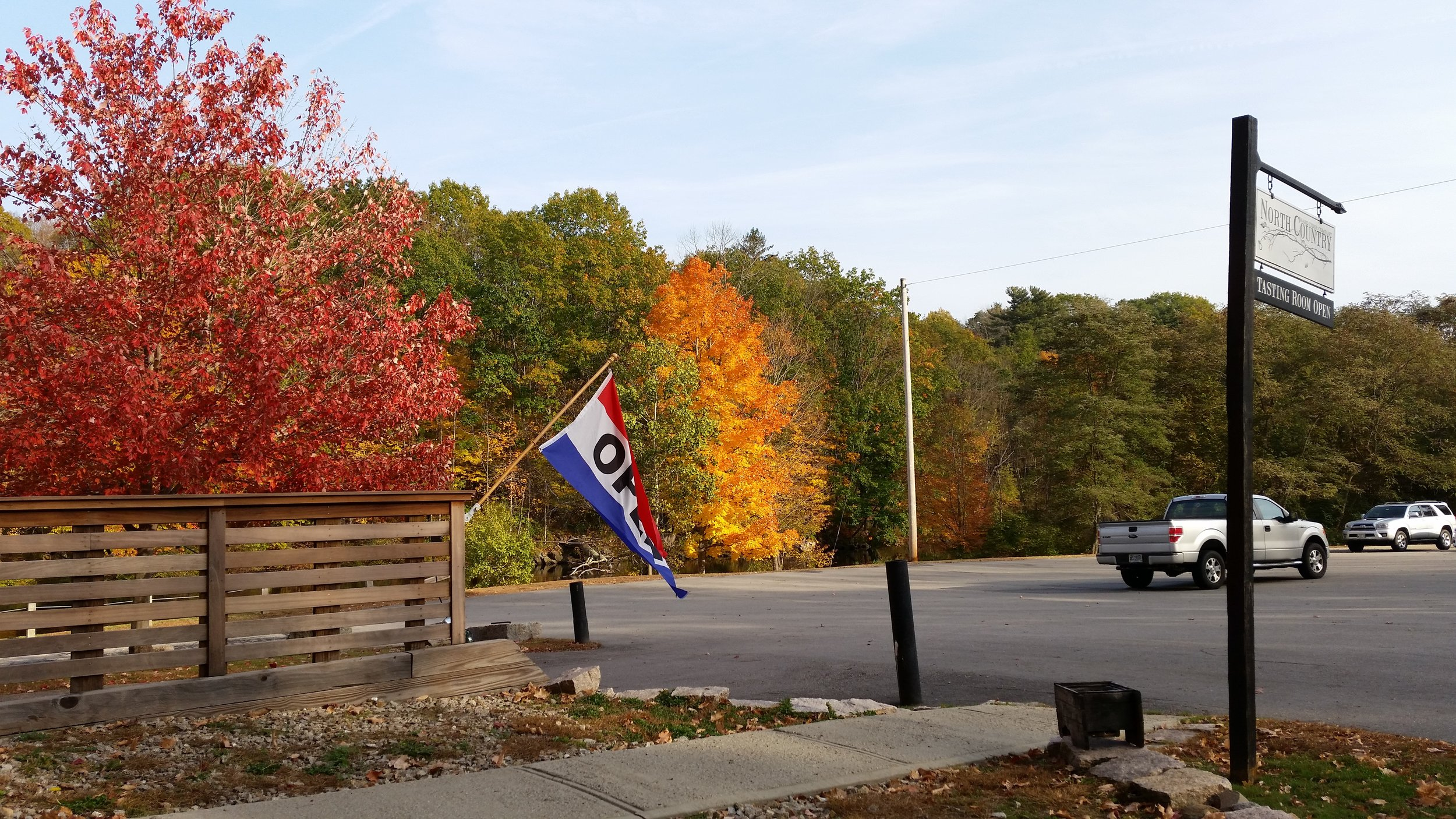 Open flag on fall day at tasting room