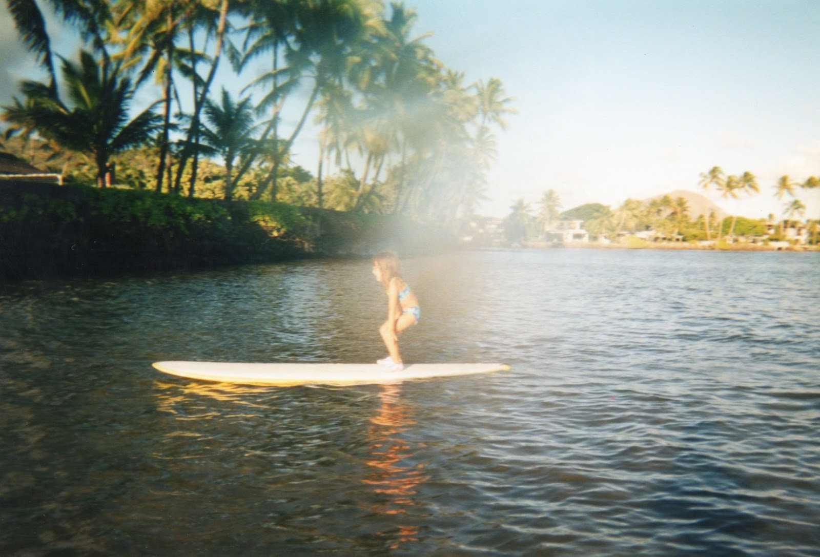 Marissa Miller, learning to surf at a young age at home in Oahu, Hawaii. Photo provided by Marissa Miller's family.