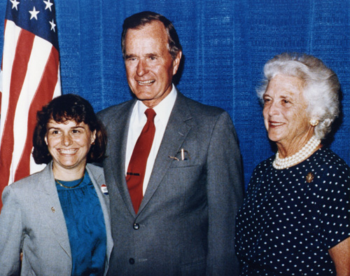 Catherine Bertini stands with Vice President George Bush and Mrs. Barbara Bush in Syracuse in 1986.