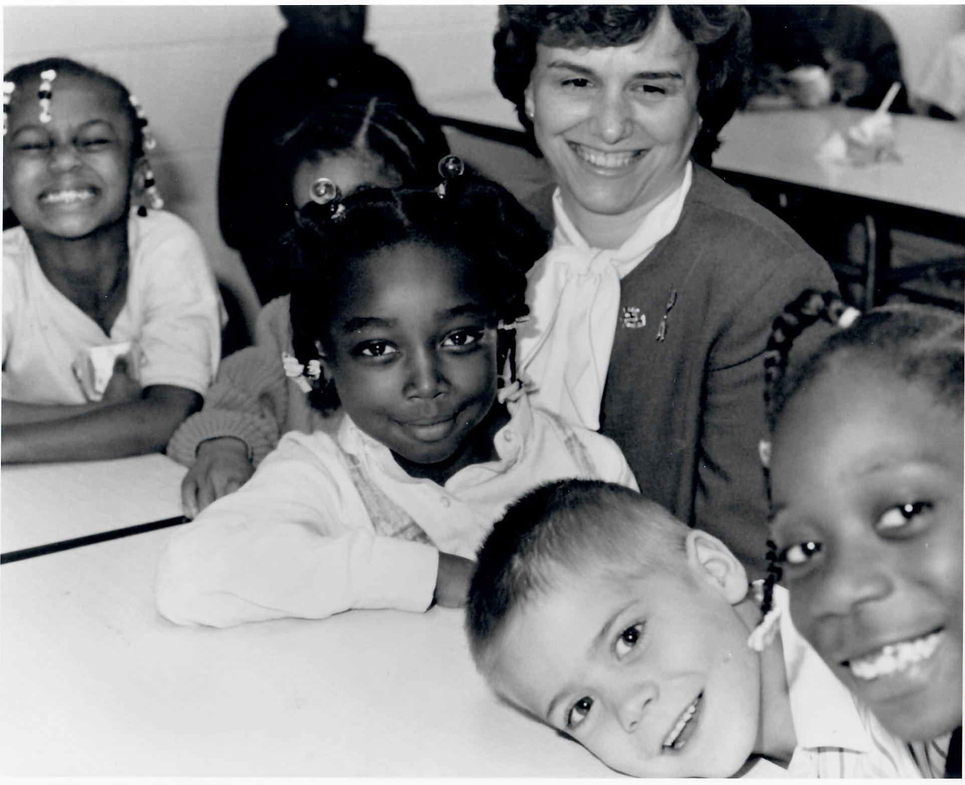 Catherine Bertini with children at a school lunch program in Syracuse, NY (1992)