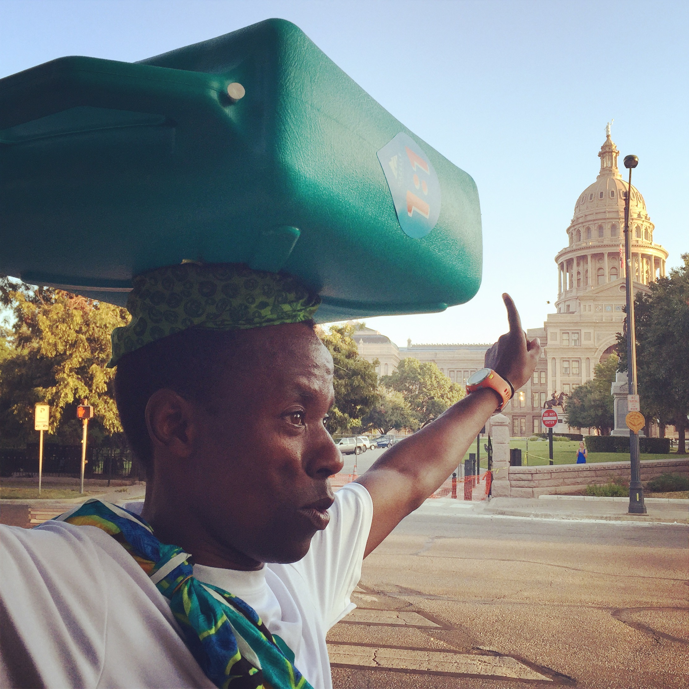 Each year, on the anniversary of his escape, Gilbert Tuhabonye walks to Austin's Capitol building carrying 50 lbs of water.
