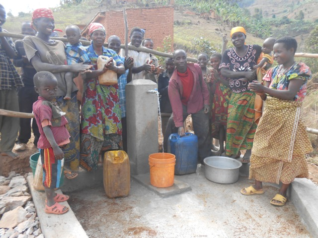 The people are happy to get clean water.JPG