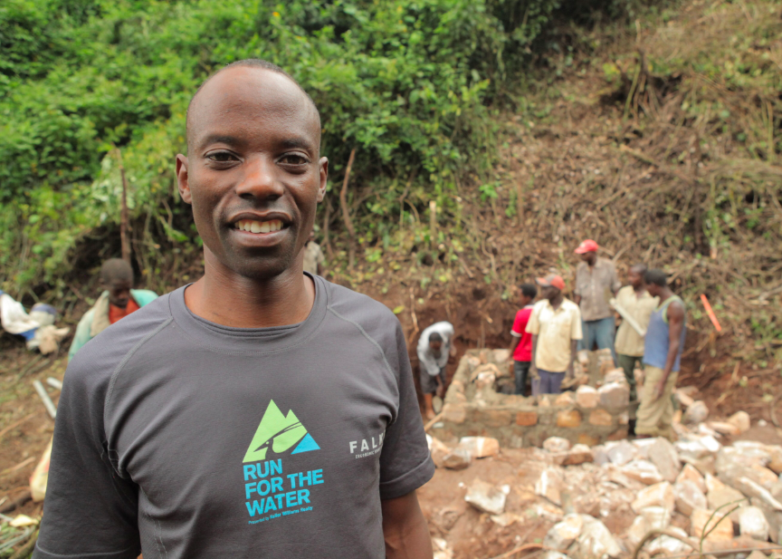 Gilbert Tuhabonye in Burundi, Africa at the sight of a water system.