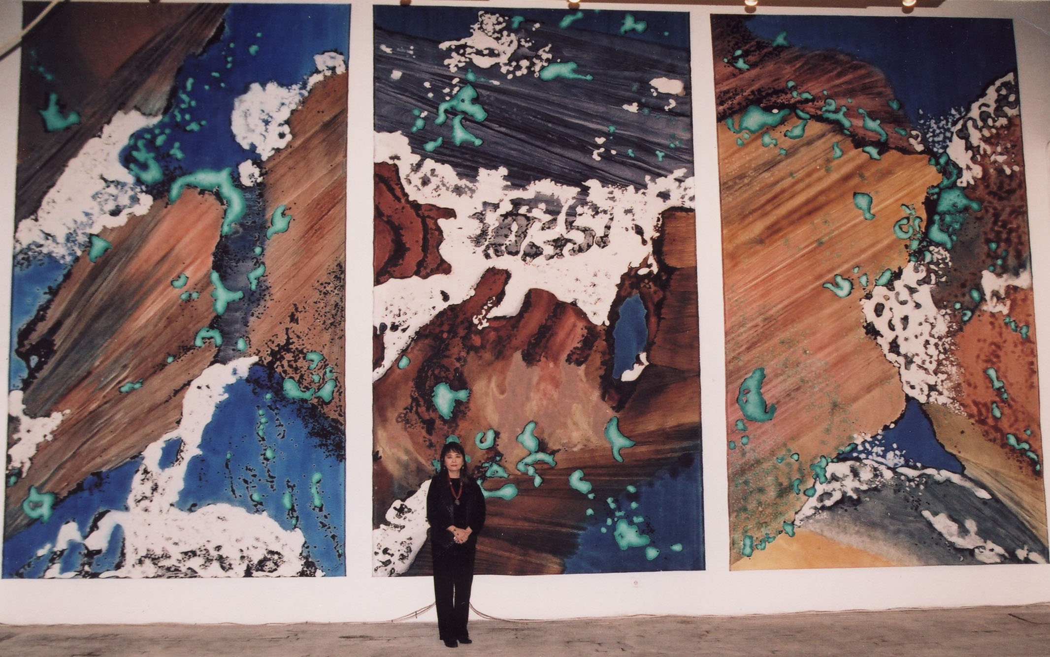 """""""Turquoise Floating I, II, III"""" with artist, 2003, Turquoise Floating Series, acrylic on canvas, tryptych, each 18 x 10 feet (549 x 305 cm)."""