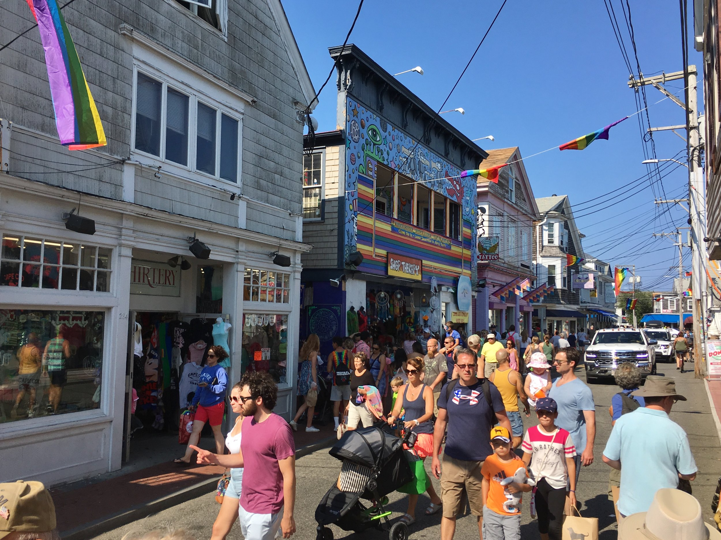 Commercial Street in Provincetown, MA, where cars are welcome but treated as guests. (Photo by the author)