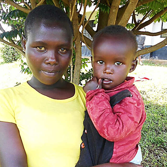 Joan chepkwemoi,  1x1 18yrs old, her baby boy is 1 and 6 months, dropped out of school in 2015 class 7, willing to go back to school but fee is a problem.jpg