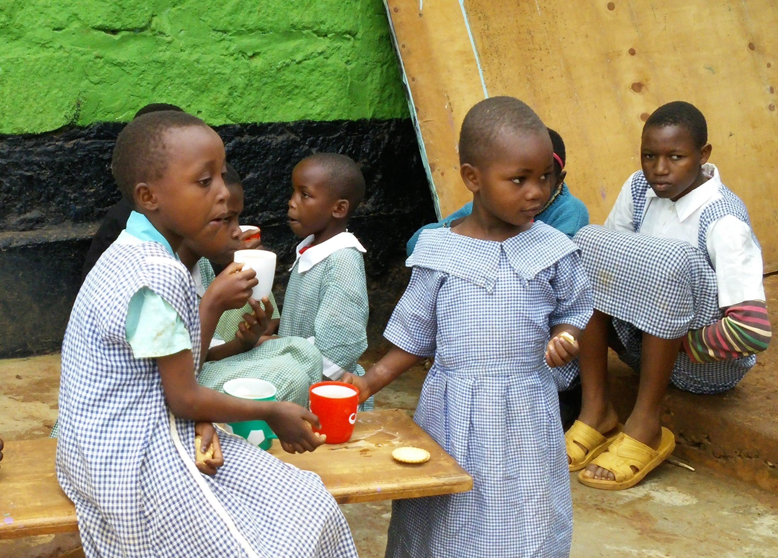 AoM girls eating.jpg