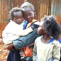 Girls of Huruma with babies vertical crop.jpg