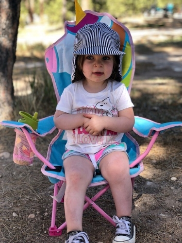 Amelia in her unicorn camping chair