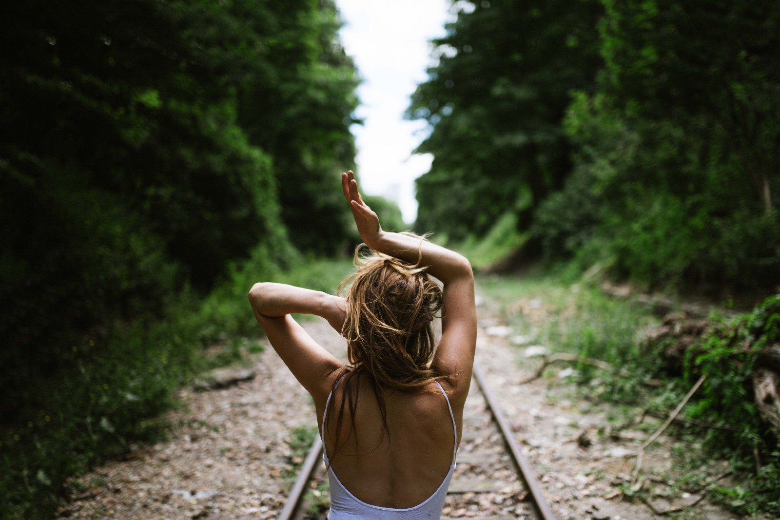 woman on railroad .jpeg