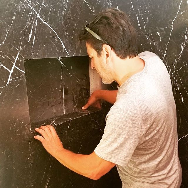Hard at #work! Installing a #beautiful black #marble #slab for a #shower in another #satisfied #customers #dreamhome www.devitishomes.com we can do it all! #contractor #construction #remodeling #socal #losangeles #bathroom #mansions #doitrightthefirsttime #interiordesign #owner