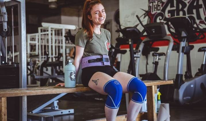 Wearing a weightlifting belt helps keep your core rigid