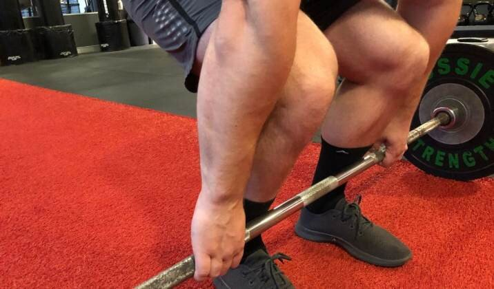 Keep bar over midline of foot and maintain the barbell on your shins