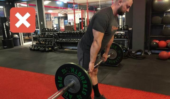 Locking your knees too early, where your shoulders are in front of the barbell, can cause knee pain while deadlifting