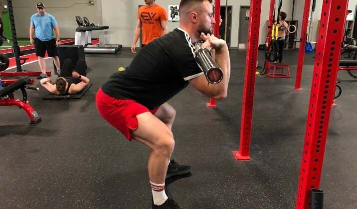 Sitting too far back when front squatting can cause wrist pain