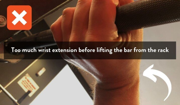 too much wrist extension can cause pain while benching.jpg