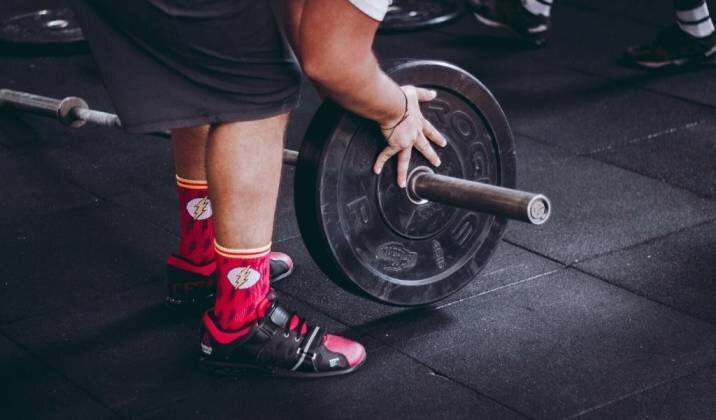 Check your footwear to make sure it's not the cause of your back pain while lifting