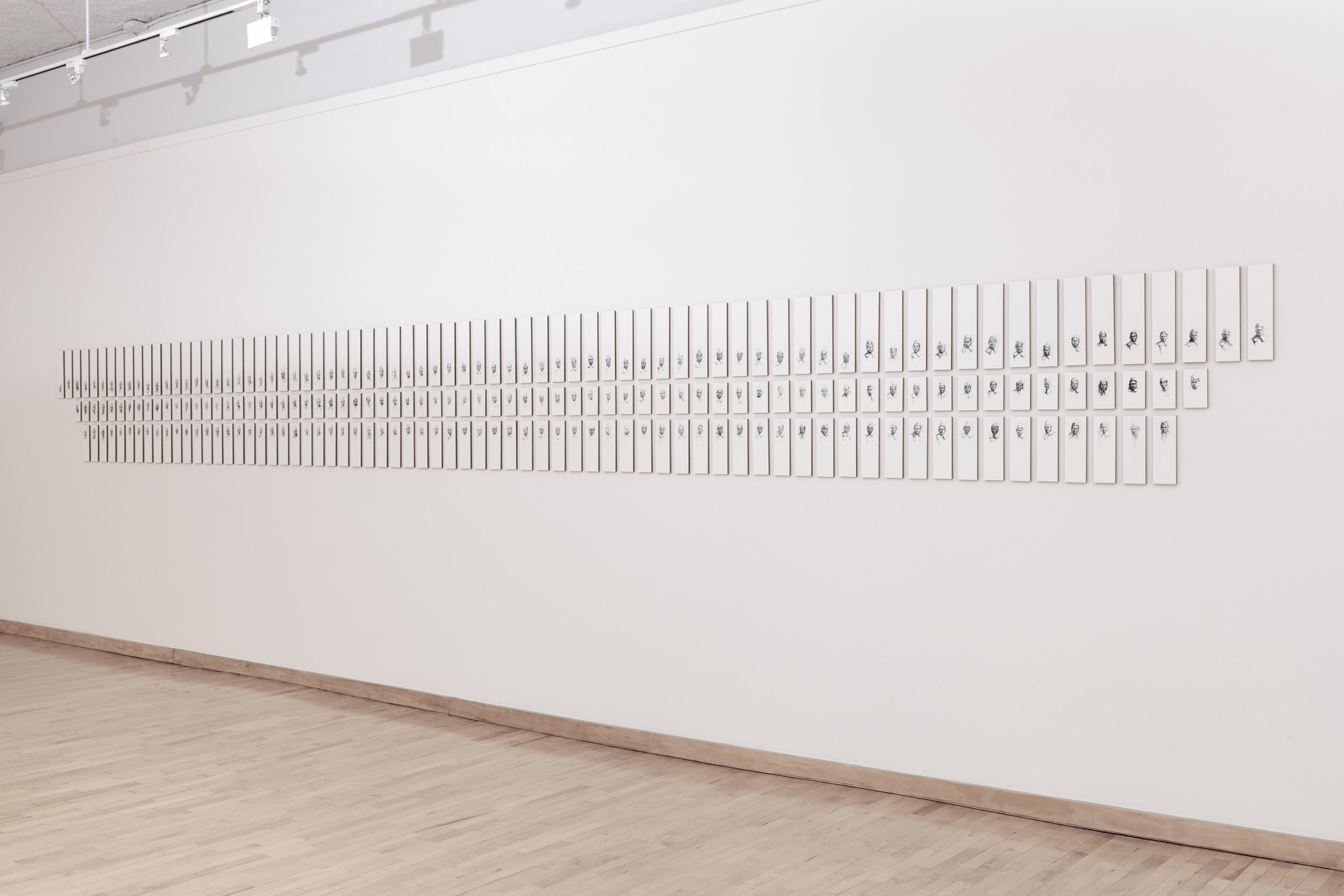 somewhere listening: Company B, 92 Division, 365th Infantry Regiment, A.E.F. 1918 - 1919, 2014  charcoal pencil on arches paper, mounted on board  An installation of 212 panels measuring 28 x 294 inches
