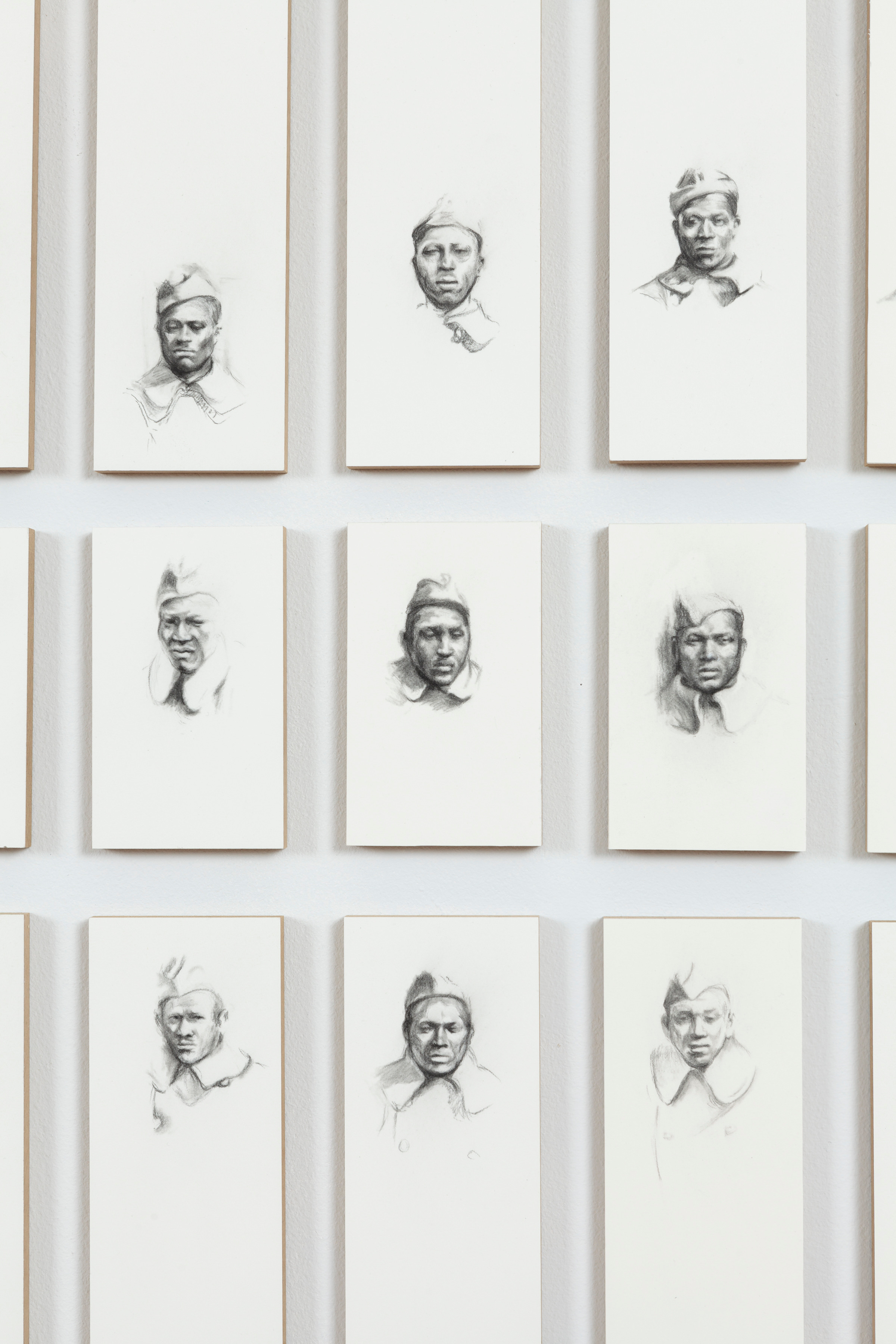 somewhere listening: Company B, 92 Division, 365th Infantry Regiment, A.E.F. 1918 - 1919 (detail), 2014  charcoal pencil on arches paper, mounted on board  An installation of 212 panels measuring 28 x 294 inches