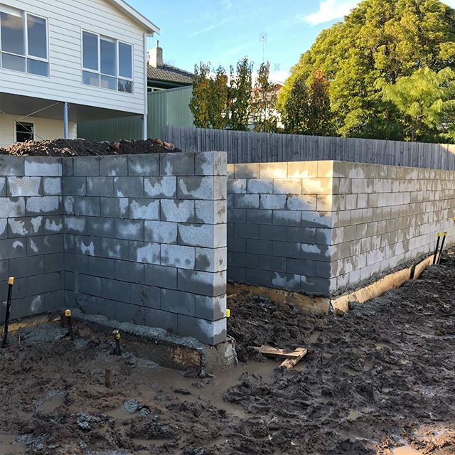 Pretty solid day at our Newtown project today core-filling this monster block wall. The wall was too far for an overhead pump and was going to be too awkward for a line pump, so we bucketed in the 4.8m3 of concrete. Barrowed down hill, then into the slush/mud, further down hill and then bucketed the concrete in. Pretty exhausted from it to be honest, glad it's done and that Delly and Zochy are machines 💪🏼 This design was by @kings_landscaping__geelong and is finally starting to take some shape #landscaping #masterlandscaper #registeredbuildingpractitioner #landscapingvictoria #landscapinggeelong #newtown #core #fill #landscape #retainingwall #landscapedesign #landscapeconstruction #design #geelong #fitness #justbyworking #solid #concrete #engineering
