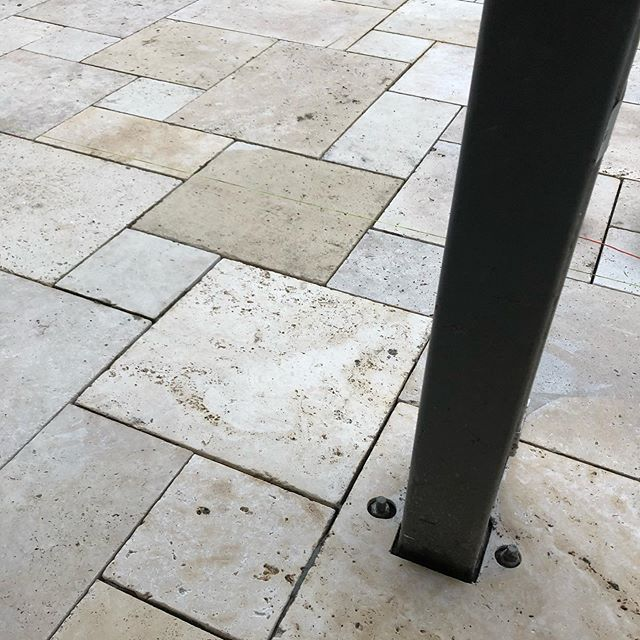 Bit of paving progress today at our Newtown project , with a couple of choice cuts around this post and footing, which included grinding the bottom of the paver. It'll get covered up eventually once the post is boxed out, but it'll look good until then #landscaping #paving #choicecuts #InStyle #Gardens #french #ashlar #travertine #pavior #newtown #geelong #landscapinggeelong #landscapedesign #choice #landscapeconstruction #masterlandscaper #registeredbuildingpractitioner #landscapingvictoria