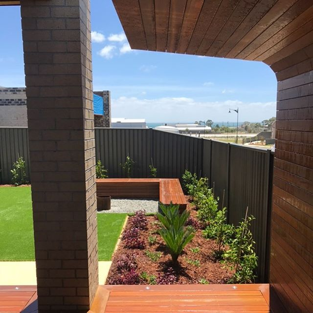 Looking back at this curved, cantilevered BBQ shelter we designed and built for a past project in Curlewis #landscaping #Bellarine #landscapedesign #landscapeconstruction #geelong #registeredbuildingpractitioner #landscapingvictoria #masterlandscaper #engineered #spottedgum #decking #pergola #bbq #shelter #timber #lumber #curves #design #landscape #foliage #plants #coastal #bellarinepeninsula #landscapinggeelong
