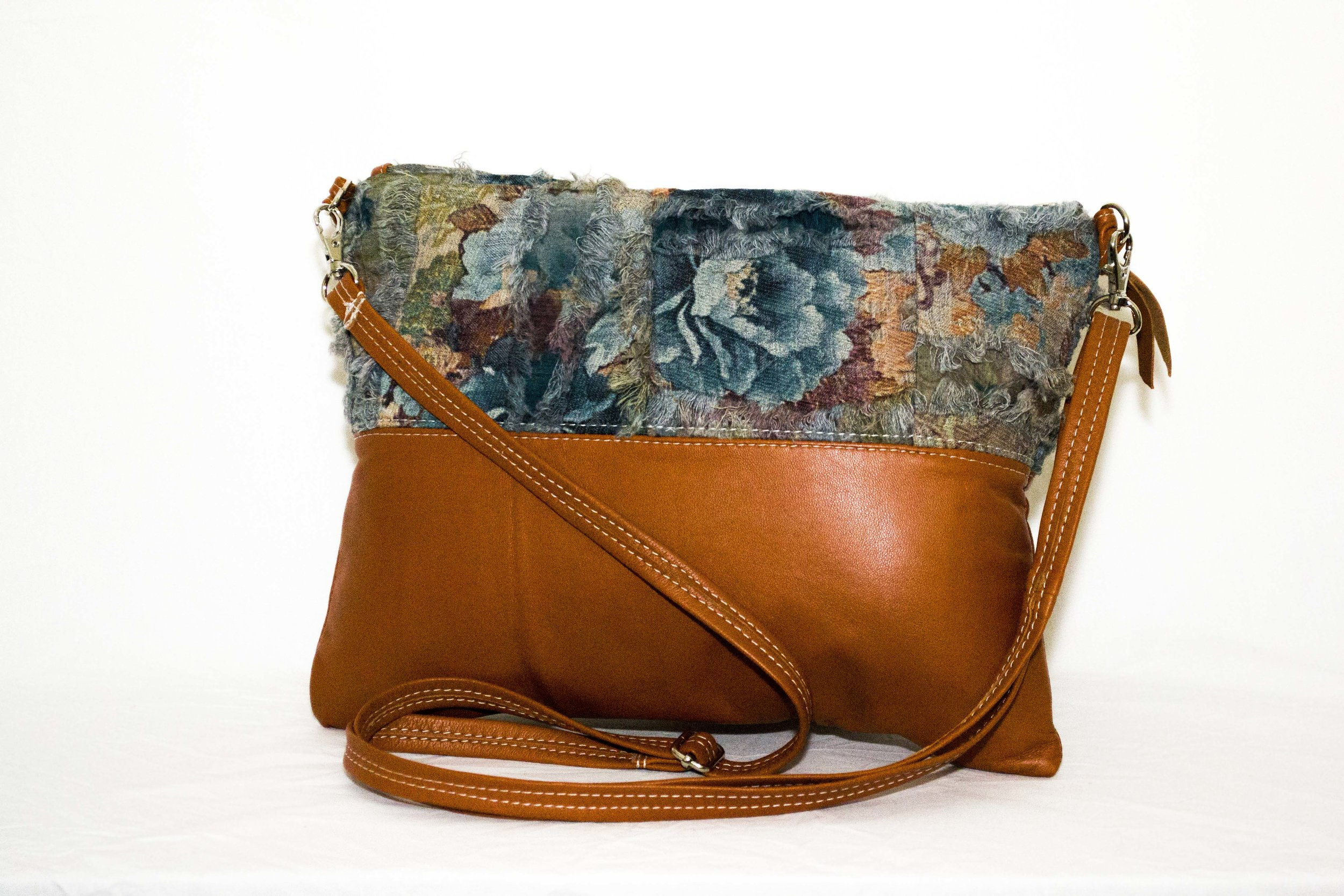 Handbags and Clutches - Rita's handbags and clutches are all individual creations and are made using different leathers and fabrics.They are available in the online shop, at markets that Rita attends and at The Sourpuss Emporium - 375 Camberwell Road, Camberwell VIC 3124.
