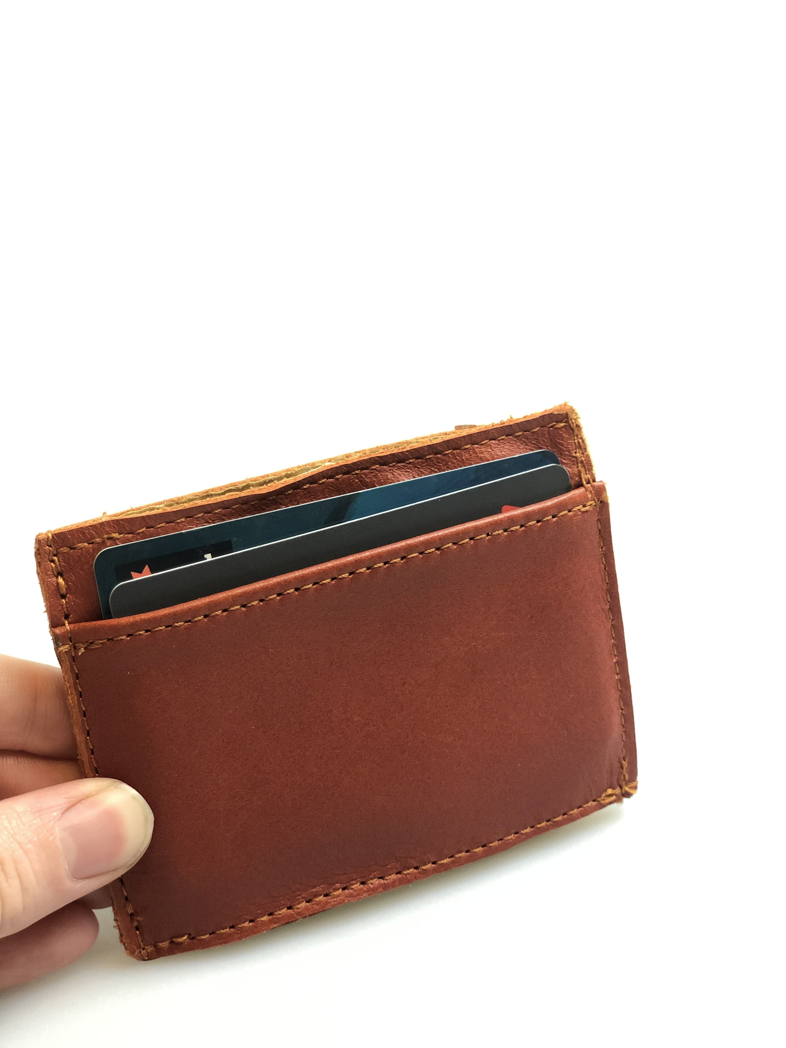Cash and card - Fits up to 8 cards and has a slot for folded notes in the centre