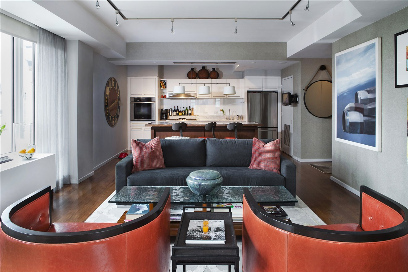 Modern living room design with couches and glass table